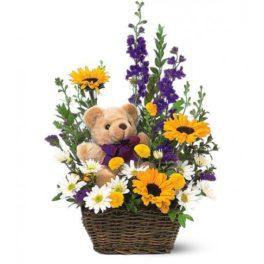 cesto di fiori freschi composizione con girasoli e orsetto peluche