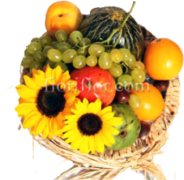 Cestino di frutta fresca di stagione e girasoli