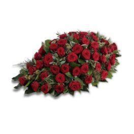 Composizione floreale funebre con rose rosse